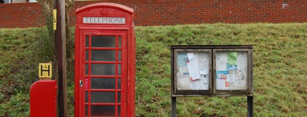 Picture of telephone box, postbox, and village noticeboard in centre of Soberton